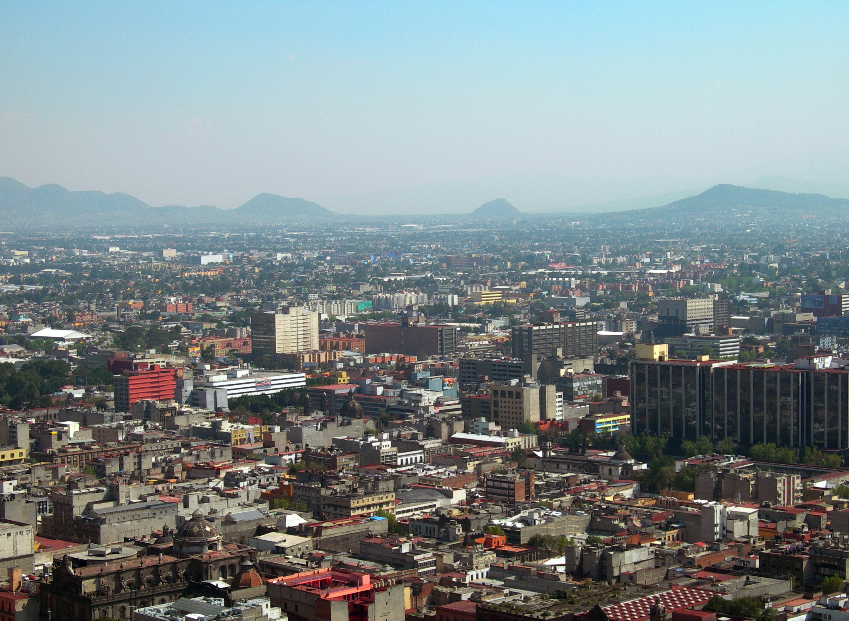 FIGURE 26. The Hill of the Star (at the far right edge of the photo) as seen from the top of the Torre Latinoamericana in downtown Mexico City, looking to the south-southeast. Photo by Byron Hamann.