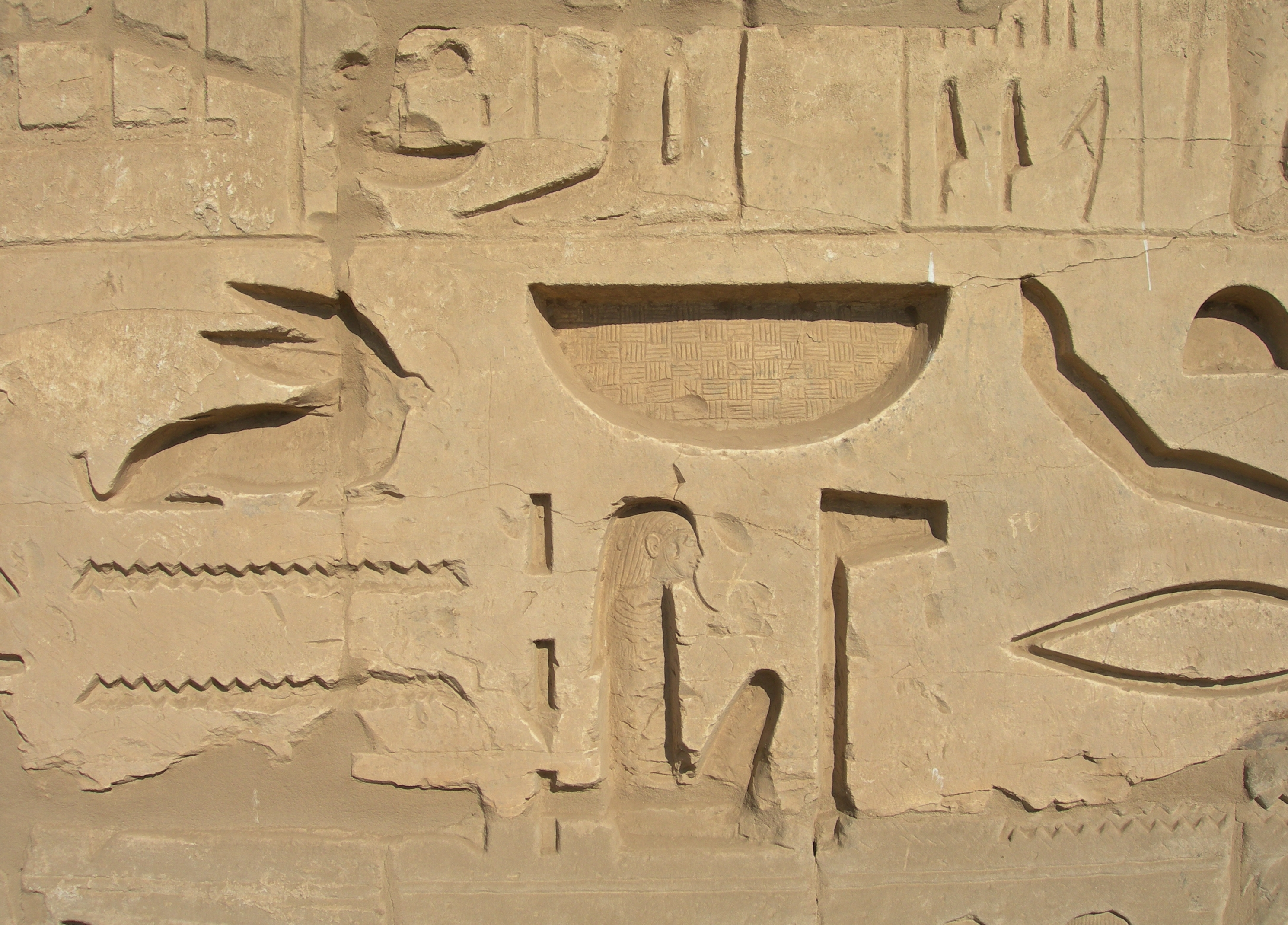 FIGURE 1. Egyptian hieroglyphs at Luxor. Note the weave-patterns carved into the round hieroglyph in the shape of a basket.