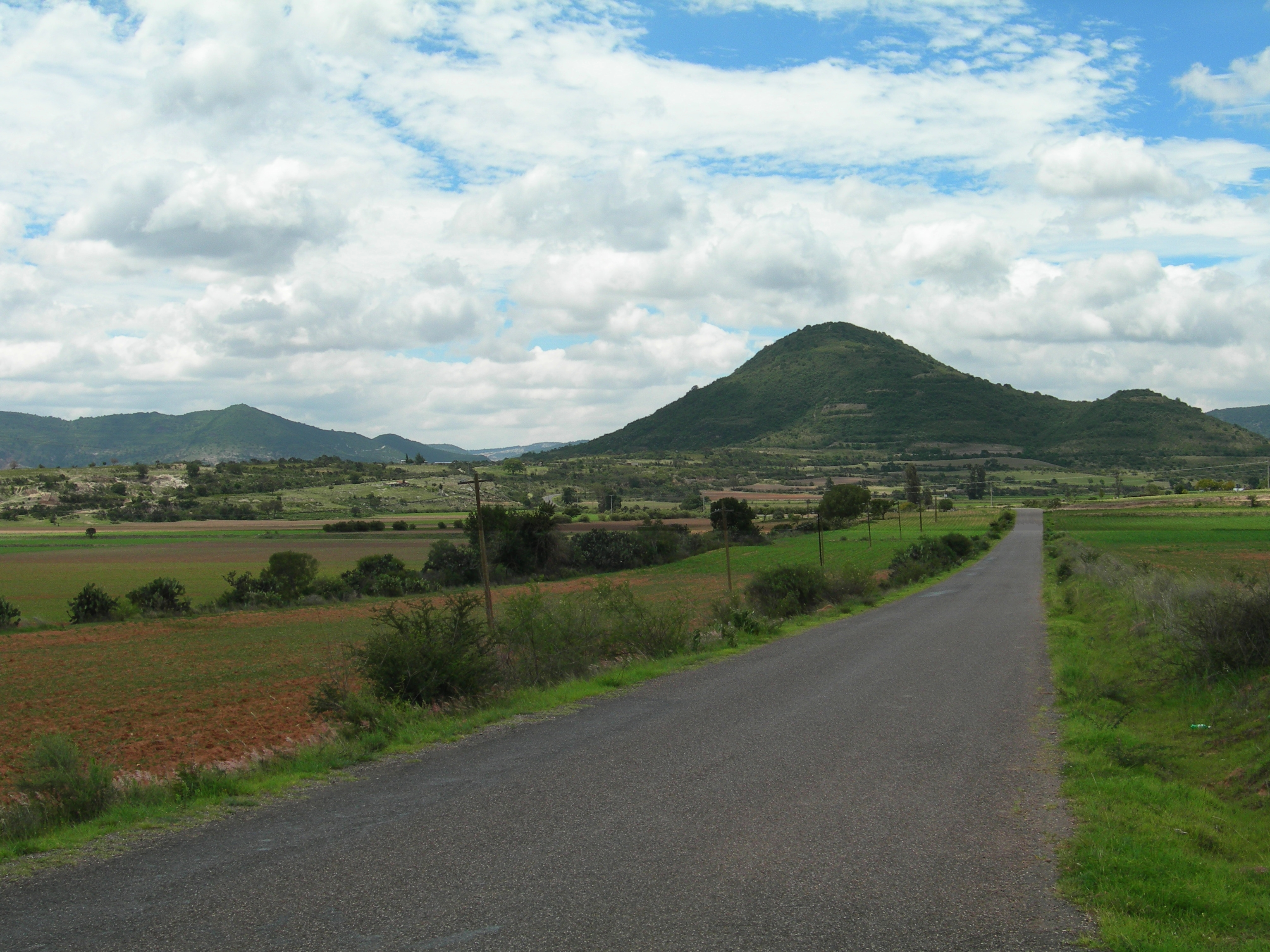 FIGURE 14. The hills of Yucuita (center) and Yucuñudahui (left), viewed from the south. June 2007. Photo by Byron Hamann.